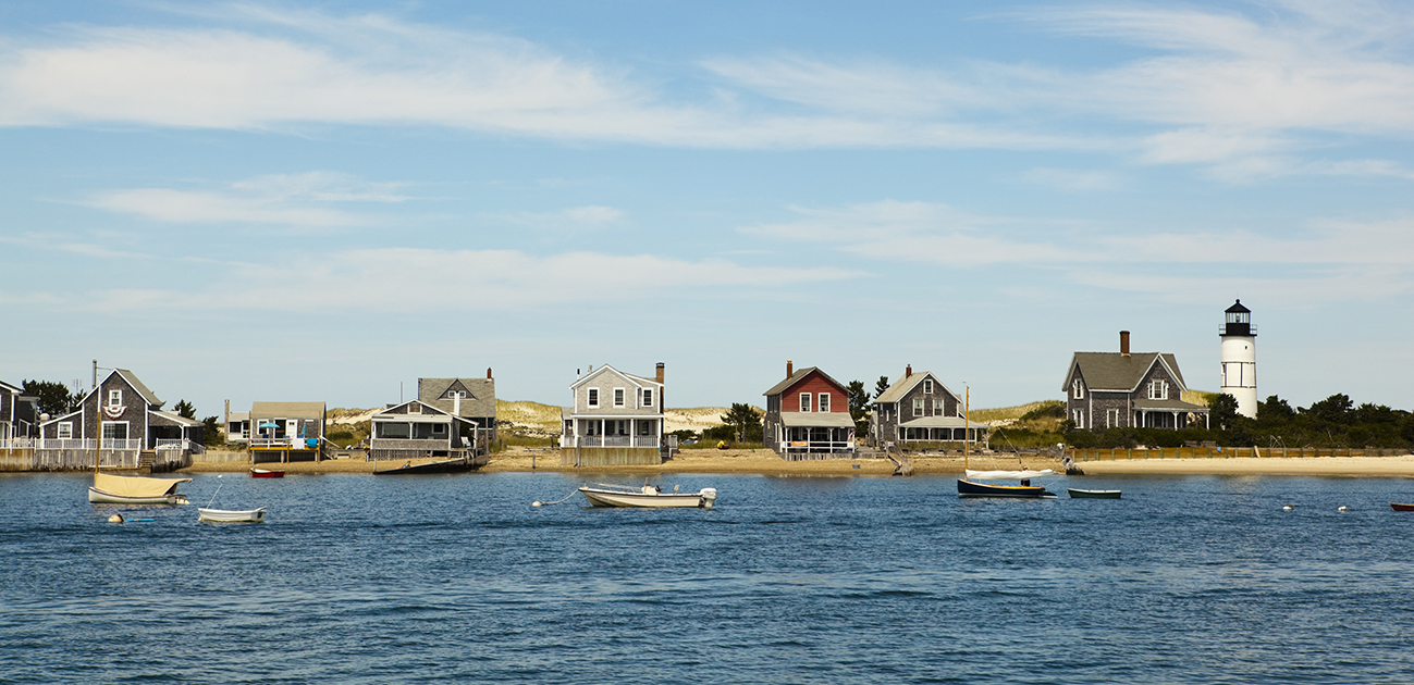 houses and lighthouse by the sea near hyannis port, massachusetts, usa